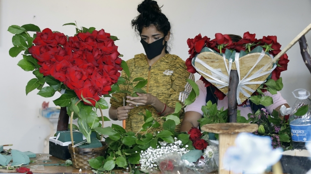 A merchant prepares a floral arrangement on Mother's Day at a Los Angeles flower market.