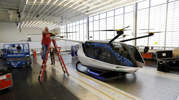 a worker prepares the Skai vehicle, developed by Alaka'i Technologies, for a special unveiling.