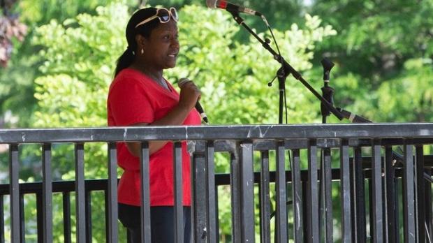 Darnisha Garbade, president of the Burlington Coalition for Dismantling Racism, addresses a crowd
