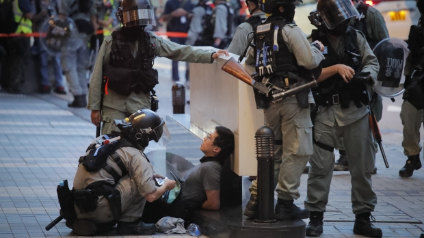 Police detain a protester in Hong Kong on July 1, 2020.