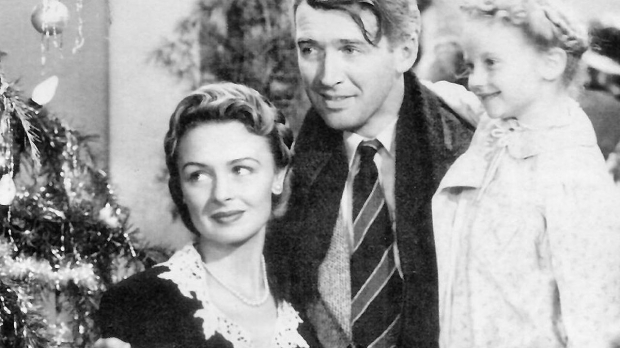 """screen shot of Jimmy Stewart, Donna Reed, and Karolyn Grimes in """"It's a Wonderful Life"""""""