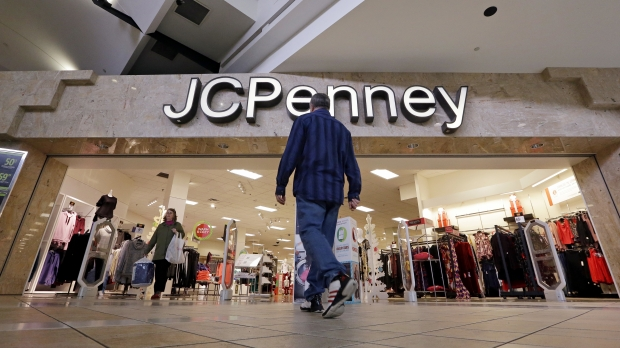Customers walk in and out of a J.C. Penny store