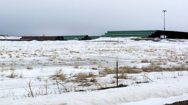 materials for Keystone XL pipeline piled in a field