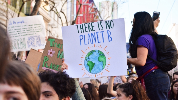 """person holding """"There is no Planet B"""" sign"""
