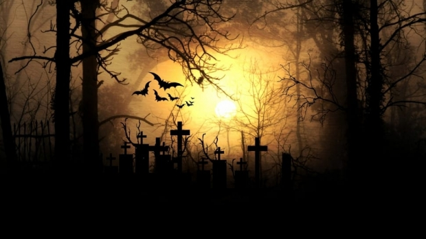 Spooky graveyard with bats
