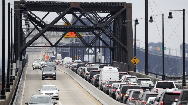 cars backed up on a bridge in traffic