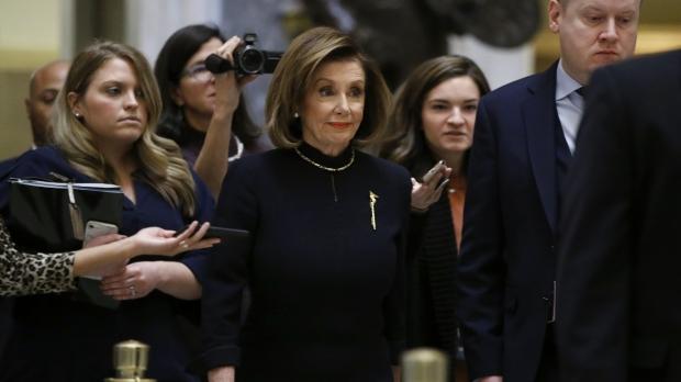 House Speaker Nancy Pelosi of Calif. walks to the House floor.