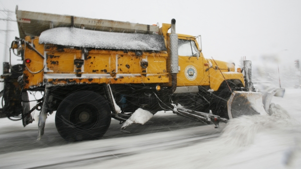 A Milwaukee County plow clears a street in Wauwatosa