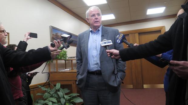 Milwaukee Mayor Tom Barrett speaks to reporters outside his office