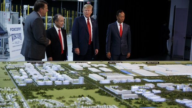President Donald Trump tours a Foxconn facility in Mt. Pleasant, Wis.