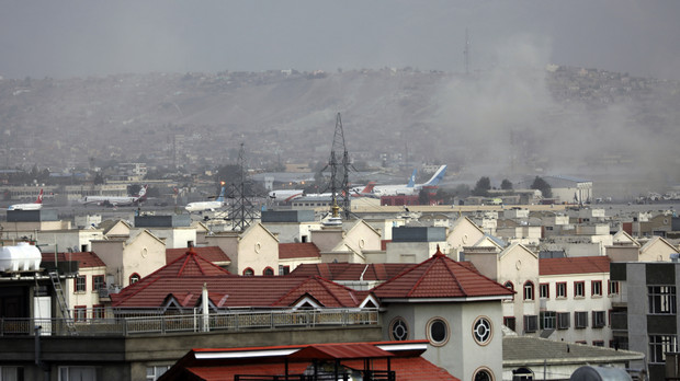 Smoke rises from a deadly explosion outside the airport in Kabul, Afghanistan