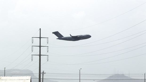 A U.S military aircraft takes off from the Hamid Karzai International Airport in Kabul, Afghanistan