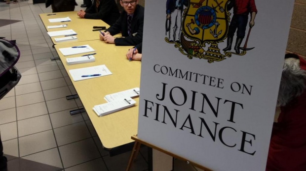 A poster with the Wisconsin crest that reads Committee on Joint Finance