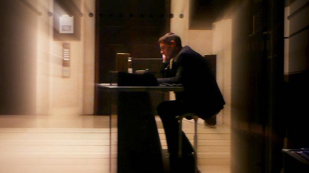 man sitting at a desk