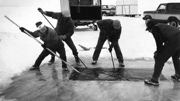 Cutting sturgeon spearing hole near Fire Lane 8, Menasha in 1983.