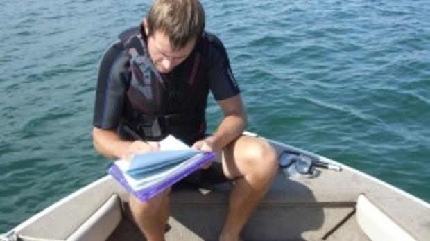 Scott Caven, Ashland County AIS Coordinator, monitoring for AIS (Photo courtesy of Scott Caven)