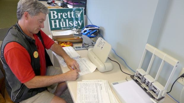 State Rep. Brett Hulsey filing his nominating petitions.