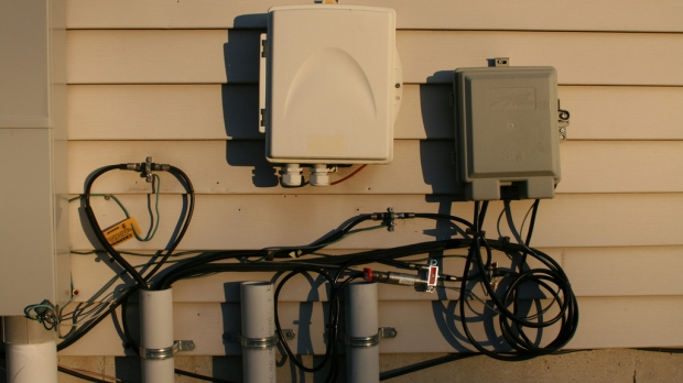 internet wiring on the side of a house