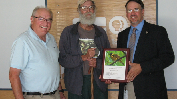 Noel Cutright receives an award for his service to Wisconsin's birds, photo by Judith Siers-Poisson