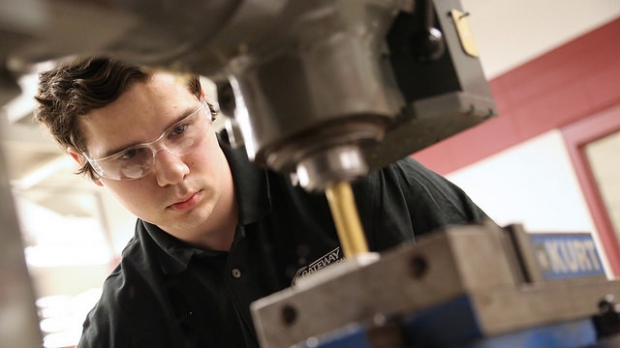 student operates machinery