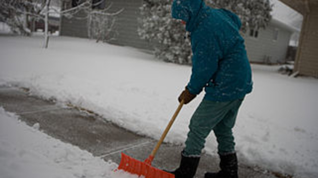 shoveling snow, image by Wikimedia Commons user Andrea Booher