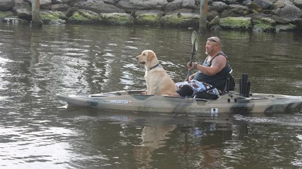 wounded warrior and dog paddling, image courtesy of Rutabaga Paddlesports