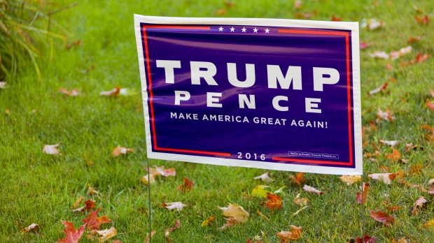 Donald Trump and Mike Pence sign in a yard