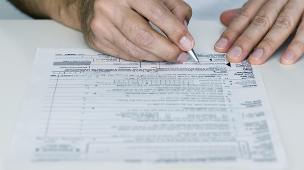 Man filling out tax return