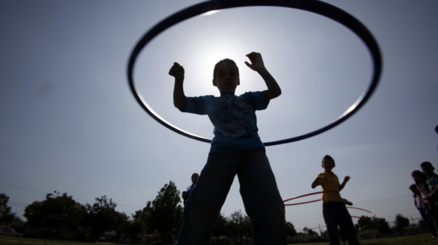 Children outside hula-hooping
