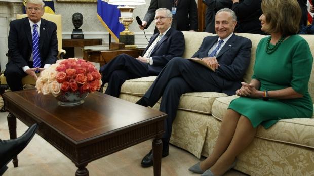 President Trump, Senator Mich McConnell and Chuck Schumer, and Representative Nancy Pelosi sit in the Oval Office