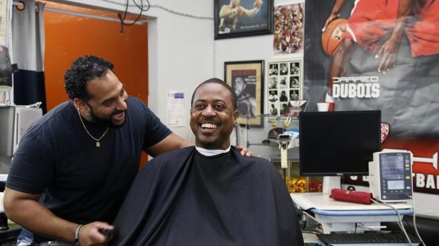 Barber talks to customer