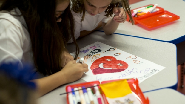 students coloring at Catholic school