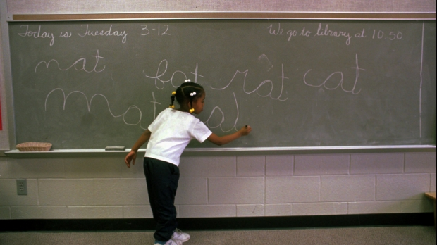 Child writing on a chalkboard