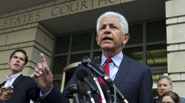 AT&T Attorney Daniel Petrocelli speaks during a news conference
