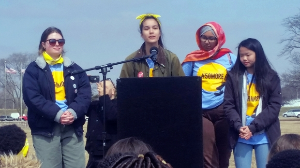 Student marchers speak at a rally