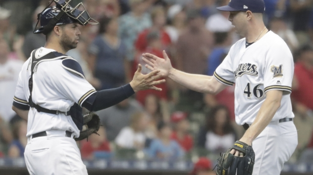 Milwaukee Brewers' Corey Knebel and Manny Pina