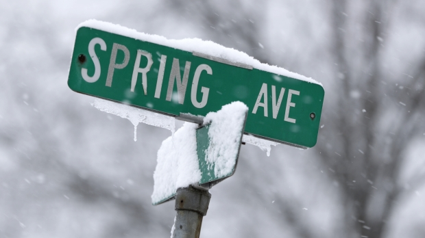 Snow on street sign