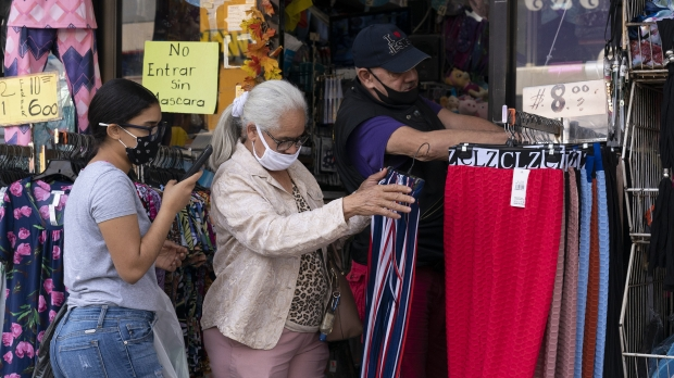 A woman shops at an outdoor clothing store in New York