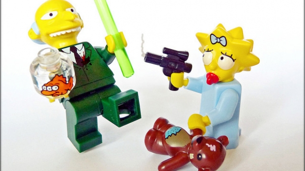 A lego recreation of Maggie Simpson shooting Mr. Burns
