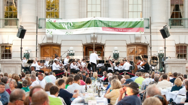 "Maestro Andrew Sewell conducts ""Concerts On The Square."""