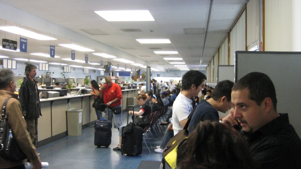 Patrons wait for service at the DMV