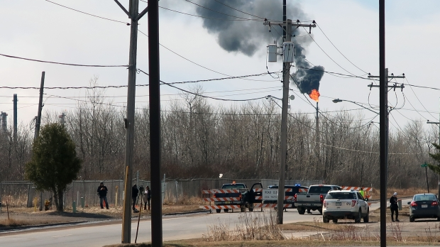 Smoke billows up from Husky Energy refinery