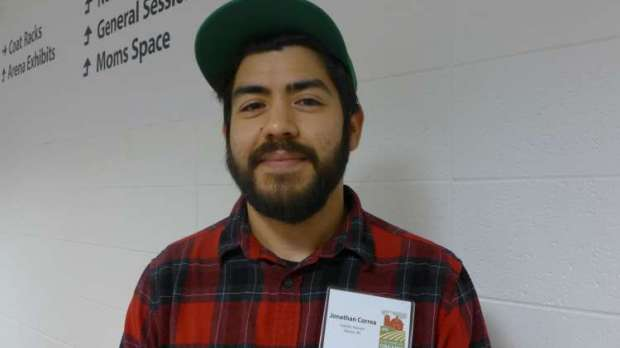 Photo of a bearded, plaid-shirted Jonathan Correa