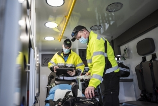 Paramedics check one of the two ambulances at their station