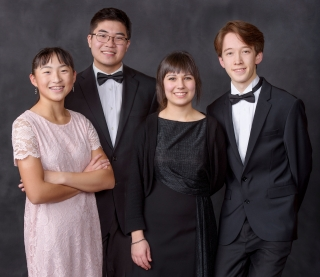 image of four high school students, two girls, two boys dressed in formal wear