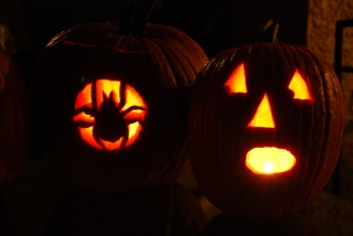 Spider and Frightened Face Carved Into Pumpkins