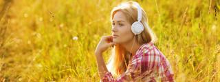 Photo of girl in field with headphones