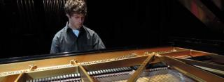Photo of young pianist at the keyboard