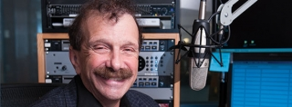 Dr. Zorba at the microphone in the WPR studio