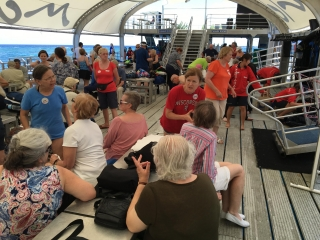 Tour group on pontoon stationed over Great Barrier Reef near Cairns, AU - Photo by Allen Rieland